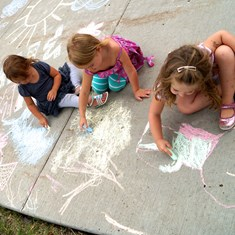 Children playing with sidewalk chalk